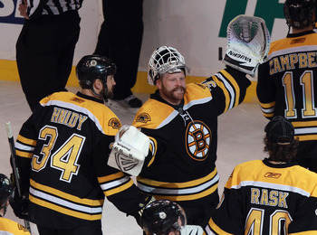BOSTON, MA - MAY 06:  Tim Thomas #30 of the Boston Bruins celebrates victory over the Philadelphia Flyers in Game Four of the Eastern Conference Semifinals during the 2011 NHL Stanley Cup Playoffs at TD Garden on May 6, 2011 in Boston, Massachusetts. The