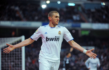 MADRID, SPAIN - MARCH 03:  Karim Benzema of Real Madrid celebrates after scoring his team's first goal during the La Liga match bewteen Real Madrid and Malaga at Estadio Santiago Bernabeu on March 3, 2011 in Madrid, Spain.  (Photo by Denis Doyle/Getty Ima