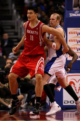 LOS ANGELES, CA - NOVEMBER 07:  Yao Ming #11 of the Houston Rockets battles for position with Chris Kaman #35 of the Los Angeles Clippers on November 7, 2008 at Staples Center in Los Angeles, California.  The Rockets won 92-83.  NOTE TO USER: User express