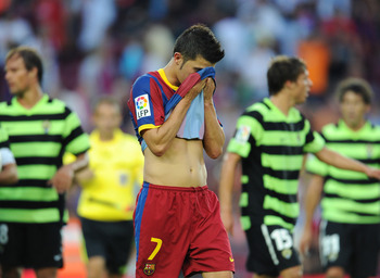 BARCELONA, SPAIN - SEPTEMBER 11:  David Villa of Barcelona trudges off the pitch at the end of the La Liga match between Barcelona and Hercules at the Camp Nou stadium on September 11, 2010 in Barcelona, Spain. Barcelona lost the match 2-0.  (Photo by Jas