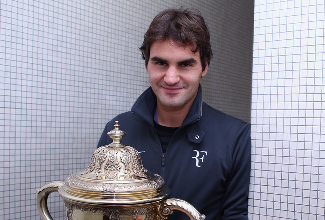 BASEL, SWITZERLAND - NOVEMBER 07:  Roger Federer of Switzerland poses for a photo with the trophy after defeating Novak Djokovic of Serbia in the final during Day Seven of the Davidoff Swiss Indoors Tennis at St Jakobshalle on November 7, 2010 in Basel, S