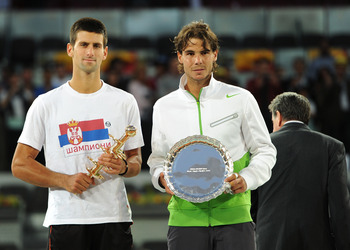MADRID, SPAIN - MAY 08:  Novak Djokovic (L) of Serbia holds the Ion Tiriac's trophy besides runner up Rafael Nadal of Spain during the price giving ceremony on day eight of the Mutua Madrilena Madrid Open Tennis on May 8, 2011 in Madrid, Spain.  (Photo by