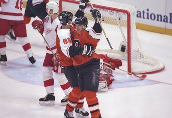 5 Jun 1997:  Center Eric Lindros (left) and leftwinger John Leclair of the Philadelphia Flyers celebrate during a playoff game against the Detroit Red Wings at Joe Louis Arena in Detroit, Michigan.  The Red Wings won the game, 6-1. Mandatory Credit: Al Be