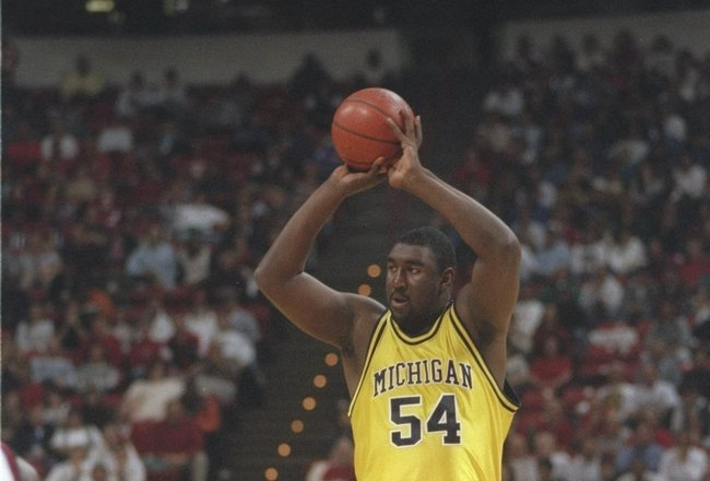 28 Dec 1995: Center Robert Traylor of the Michigan Wolverines looks to pass the ball during a game against the UNLV Rebels in Las Vegas, Nevada. UNLV won the game, 66-64.