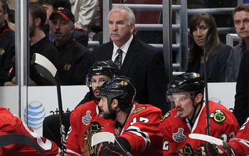 CHICAGO - MAY 31:  Head coach Joel Quenneville of the Chicago Blackhawks looks on from the bench in the second period while taking on the Philadelphia Flyers in Game Two of the 2010 NHL Stanley Cup Final at the United Center on May 31, 2010 in Chicago, Il