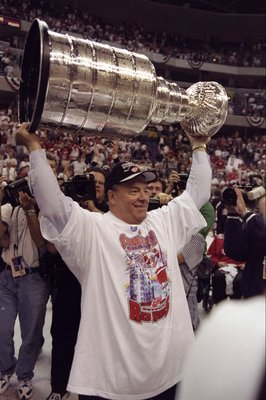 16 Jun 1998:  Scotty Bowman of the Detroit Red Wings holds up the Stanley Cup during the Stanley Cup Finals game against the Washington Capitals at the MCI Center in Washington, D. C.. The Red Wings defeated the Capitals 4-1. Mandatory Credit: Rick Stewar