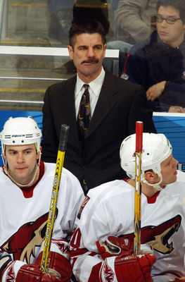 WASHINGTON - JANUARY 7:  Head coach Bob Francis of the Phoenix Coyotes looks on from behind the bench against the Washington Capitals during the game at MCI Center on January 7, 2004 in Washington D.C.  The Coyotes defeated the Capitals 3-0.  (Photo by Mi