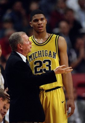 28 Dec 1995:  Head coach Steve Fisher and forward Maurice Taylor of the Michigan Wolverines confer during a game against the UNLV Runnin'' Rebels.  UNLV won the game, 66-64. Mandatory Credit: Stephen Dunn  /Allsport