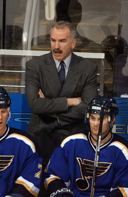 WASHINGTON - JANUARY 28:  Head coach Joel Quenneville of the St. Louis Blues watches the game against the Washington Capitals at the MCI Center on January 28, 2003 in Washington, DC. The Blues defeated the Capitals 5-3. (Photo by Mitchell Layton/Getty Ima