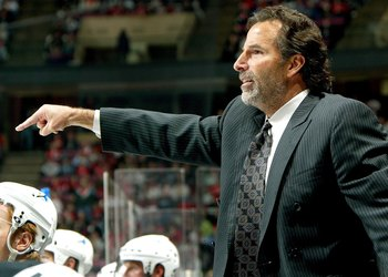 EAST RUTHERFORD, NJ - APRIL 14:  Head coach John Tortorella of the Tampa Bay Lightning yells to his team against the New Jersey Devils in Game 2 of the 2007 Eastern Conference Quarterfinals on April 14, 2007 at Continental Airlines Arena in East Rutherfor