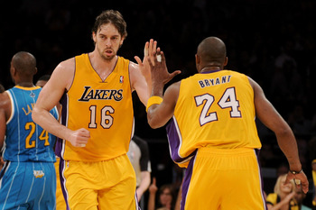 LOS ANGELES, CA - APRIL 26:  Pau Gasol #16 reacts with teammate Kobe Bryant #24 of the Los Angeles Lakers in the third quarter while taking on the New Orleans Hornets in Game Five of the Western Conference Quarterfinals in the 2011 NBA Playoffs on April 2