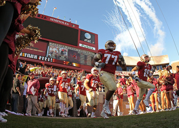TALLAHASSEE, FL - NOVEMBER 27:  The Florida State Seminoles run out of the tunnel during a game against the Florida Gators at Doak Campbell Stadium on November 27, 2010 in Tallahassee, Florida.  (Photo by Mike Ehrmann/Getty Images)