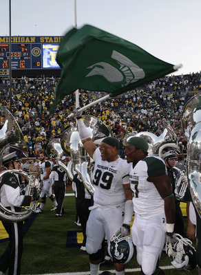 ANN ARBOR, MI - OCTOBER 09: Jerel Worthy #99 of the Michigan State Spartans waves the Spartan Flag after defeating the Michigan Wolverines 34-17 on October 9, 2010 at Michigan Stadium in Ann Arbor, Michigan. (Photo by Leon Halip/Getty Images)