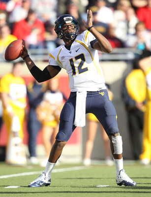 LOUISVILLE, KY - NOVEMBER 20: Geno Smith#12 of the West Virginia Mountaineers throws a pass during the Big East Conference game against the Louisville Cardinals at Papa John's Cardinal Stadium on November 20, 2010 in Louisville, Kentucky.  (Photo by Andy