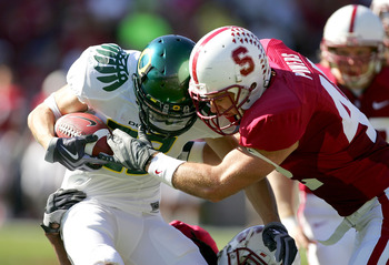 PALO ALTO, CA - NOVEMBER 07:  Jeff Maehl #23 of the Oregon Ducks is tackled by Will Powers #42 of the Stanford Cardinal at Stanford Stadium on November 7, 2009 in Palo Alto, California.  (Photo by Ezra Shaw/Getty Images)