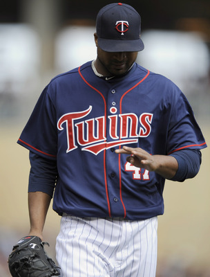 MINNEAPOLIS, MN - APRIL 13: Francisco Liriano #47 of the Minnesota Twins looks as his hand as he walks to the Twins' dugout during their game against the Kansas City Royals on April 13, 2011 at Target Field in Minneapolis, Minnesota. Royals defeated the T