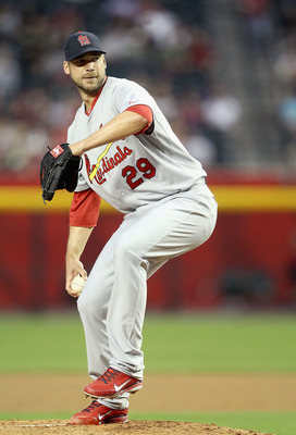 PHOENIX, AZ - APRIL 12:  Starting pitcher Chris Carpenter #29 of the St. Louis Cardinals pitches against the Arizona Diamondbacks during the Major League Baseball game at Chase Field on April 12, 2011 in Phoenix, Arizona. The Diamondbacks defeated the Car