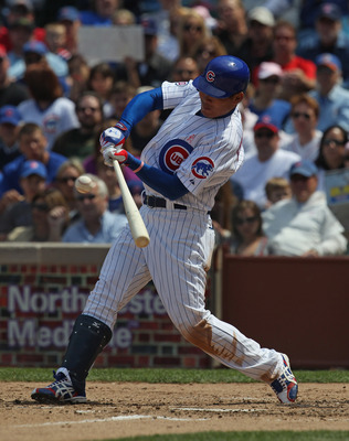 CHICAGO, IL - MAY 08  Kosuke Fukudome #1 of the Chicago Cubs hits the ball against the Cincinnati Reds at Wrigley Field on May 8, 2011 in Chicago, Illinois. The Reds defeated the Cubs 2-0. (Photo by Jonathan Daniel/Getty Images)