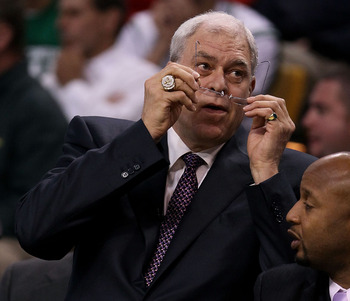 BOSTON - JUNE 10:  Head coach Phil Jackson of the Los Angeles Lakers adjusts his glasses in the first half against the Boston Celltics during Game Four of the 2010 NBA Finals on June 10, 2010 at TD Garden in Boston, Massachusetts. NOTE TO USER: User expre