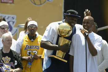 LOS ANGELES - JUNE 14: Brian Shaw #20 and Shaquille O'Neal #34 of the Los Angeles Lakers speak to the fans in front of the Staples Center following the victory parade on June 14, 2002 at Staples Center in Los Angeles, California.  The Lakers won their thi