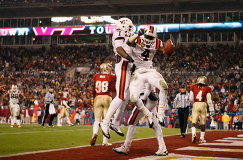CHARLOTTE, NC - DECEMBER 04:  David Wilson #4 of the Virginia Tech Hokies celebrates after scoring a touchdown with teammate Marcus Davis during their game against the Florida State Seminoles at Bank of America Stadium on December 4, 2010 in Charlotte, No