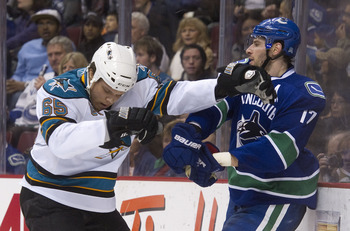 VANCOUVER, CANADA - JANUARY 20: Ryan Kesler #17 of the Vancouver Canucks and Derek Joslin #65 of the San Jose Sharks push and shove behind the play during the second period in NHL action on January 20, 2011 at Rogers Arena in Vancouver, BC, Canada.  (Phot