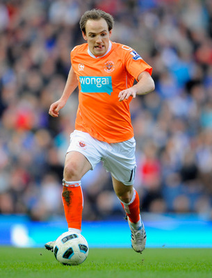 BLACKBURN, ENGLAND - MARCH 19: David Vaughan of Blackpool on the ball during the Barclays Premier League match between Blackburn Rovers and Blackpool at Ewood Park on March 19, 2011 in Blackburn, England.  (Photo by Michael Regan/Getty Images)