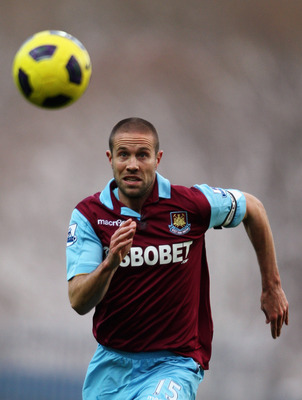 BLACKBURN, ENGLAND - DECEMBER 18:  Matthew Upson of West Ham chases the lose ball during the Barclays Premier League match between Blackburn Rovers and West Ham United at Ewood park on December 18, 2010 in Blackburn, England.  (Photo by Dean Mouhtaropoulo