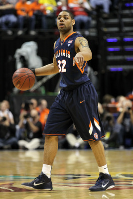 INDIANAPOLIS, IN - MARCH 11:  Demetri McCamey #32 of the Illinois Fighting Illini looks to pass the ball against the Michigan Wolverines during the quarterfinals of the 2011 Big Ten Men's Basketball Tournament at Conseco Fieldhouse on March 11, 2011 in In