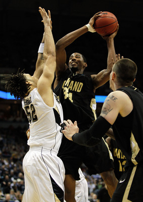 MILWAUKEE - MARCH 19:  Keith Benson #34 of the Oakland Golden Grizzlies shoots the ball over Gary McGhee #52 of the Pittsburgh Panthers in the first half during the first round of the 2010 NCAA men's basketball tournament at the Bradley Center on March 19