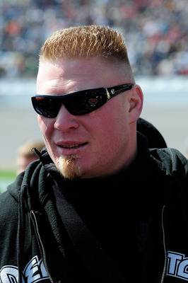 DAYTONA BEACH, FL - FEBRUARY 13:  MMA fighter Brock Lesnar walks in the garage area during the NASCAR Nationwide Series Drive4COPD 300 at Daytona International Speedway on February 13, 2010 in Daytona Beach, Florida.  (Photo by Sam Greenwood/Getty Images)
