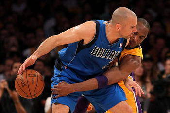 LOS ANGELES, CA - MAY 04:  Jason Kidd #2 of the Dallas Mavericks moves the ball as Kobe Bryant #24 of the Los Angeles Lakers goes for the steal in the first quarter in Game Two of the Western Conference Semifinals in the 2011 NBA Playoffs at Staples Cente