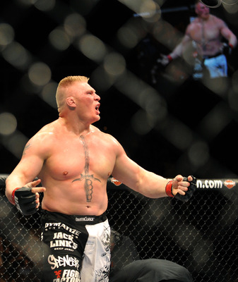 LAS VEGAS - JULY 11:  Brock Lesnar reacts after knocking out Frank Mir during their heavyweight title bout during UFC 100 on July 11, 2009 in Las Vegas, Nevada.  (Photo by Jon Kopaloff/Getty Images)
