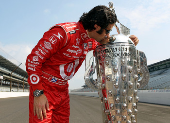 INDIANAPOLIS - MAY 31:  Dario Franchitti of Scotland, driver of the #10 Target Chip Ganassi Racing Dallara Honda, kisses the Borg Warner trophy on the yard of brick during the 94th Indianapolis 500 Trohpy Presentation on May 31, 2010 in Indianapolis, Indi