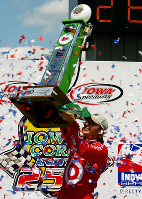 NEWTON, IA - JUNE 22:  Dan Wheldon, driver of the #10 Target Chip Ganassi Racing Dallara Honda celebrates winning the IRL Indycar Series Iowa Corn Indy 250 on June 22, 2008 at the Iowa Speedway in Newton, Iowa.  (Photo by Darrell Ingham/Getty Images)