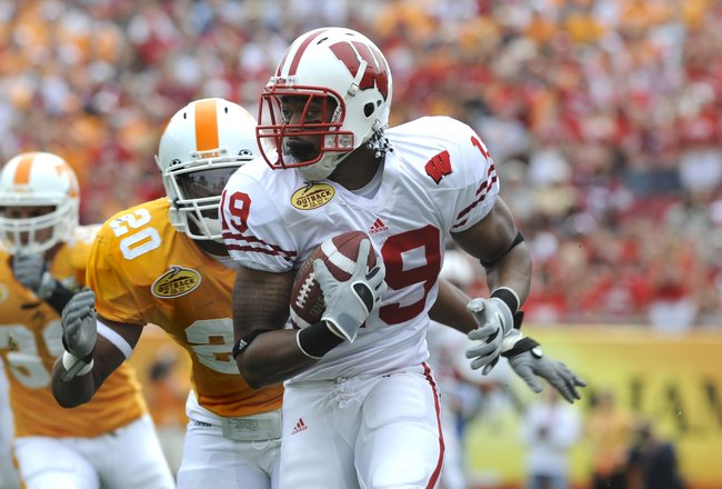 TAMPA, FL -  JANUARY 1: Wide receiver Paul Hubbard #19 of the Wisconsin Badgers rushes upfield against the Tennessee Volunteers in the 2008 Outback Bowl at Raymond James Stadium on January 1, 2008 in Tampa, Florida.  The Volunteers won 21 - 17. (Photo by