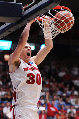 TUCSON, AZ - MARCH 19:  Jon Leuer #30 of the Wisconsin Badgers dunks against the Kansas State Wildcats in the first half during the third round of the 2011 NCAA men's basketball tournament at McKale Center on March 19, 2011 in Tucson, Arizona.  (Photo by