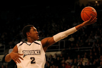 PROVIDENCE, RI - DECEMBER 04:  Marshon Brooks #2 of the Providence Friars drives for a shot attempt against the Rhode Island Rams at the Dunkin' Donuts Center on December 4, 2010 in Providence, Rhode Island.  (Photo by Chris Chambers/Getty Images)