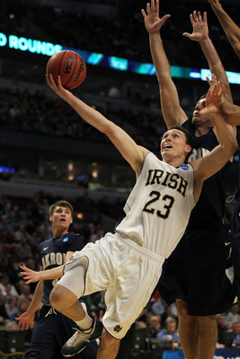 CHICAGO, IL - MARCH 18:  Ben Hansbrough #23 of the Notre Dame Fighting Irish shoots against Nikola Cvetinovic #13 of the Akron Zips in the first half during the second round of the 2011 NCAA men's basketball tournament at the United Center on March 18, 20