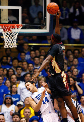 DURHAM, NC - MARCH 03:  David McClure #14 of the Duke Blue Devils draws an offensive foul from Chris Singleton #31 of the Florida State Seminoles during the game on March 3, 2009 at Cameron Indoor Stadium in Durham, North Carolina.  (Photo by Kevin C. Cox