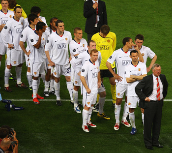 ROME - MAY 27:  Sir Alex Ferguson manager of Manchester United and his players stand dejected after Barcelona won the UEFA Champions League Final match between Manchester United and Barcelona at the Stadio Olimpico on May 27, 2009 in Rome, Italy. Barcelon