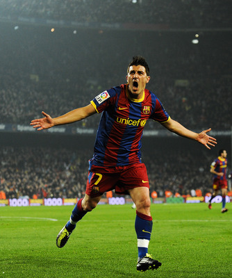 BARCELONA, SPAIN - JANUARY 16:  David Villa of FC Barcelona celebrates after scoring his side's second goal during the La Liga match between FC Barcelona and Malaga at Nou Camp on January 16, 2011 in Barcelona, Spain.  (Photo by David Ramos/Getty Images)