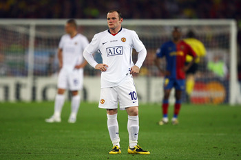 ROME - MAY 27:  Wayne Rooney of Manchester United looks dejected after Lionel Messi of Barcelona scored the second goal for Barcelona during the UEFA Champions League Final match between Barcelona and Manchester United at the Stadio Olimpico on May 27, 20