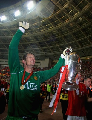 MOSCOW - MAY 21:  Edwin Van der Sar of Manchester United celebrates with the trophy following his team's victory during the UEFA Champions League Final match between Manchester United and Chelsea at the Luzhniki Stadium on May 21, 2008 in Moscow, Russia.