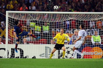 ROME - MAY 27:  Lionel Messi of Barcelona scores the second goal for Barcelona during the UEFA Champions League Final match between Barcelona and Manchester United at the Stadio Olimpico on May 27, 2009 in Rome, Italy.  (Photo by Shaun Botterill/Getty Ima