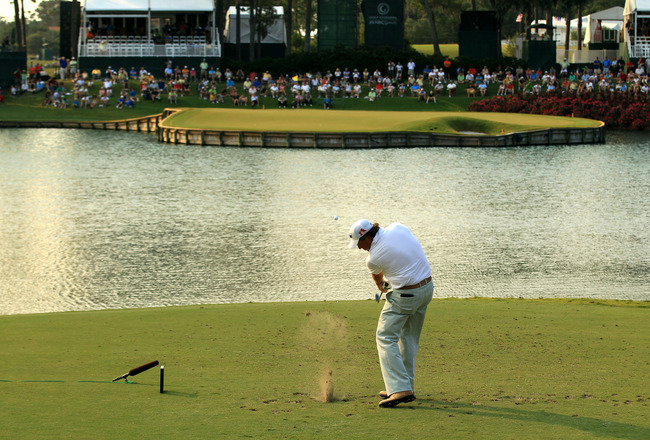 PONTE VEDRA BEACH, FL - MAY 12:  Phil Mickelson hits his tee shot on the 17th hole during the first round of THE PLAYERS Championship held at THE PLAYERS Stadium course at TPC Sawgrass on May 12, 2011 in Ponte Vedra Beach, Florida.  (Photo by Streeter Lec