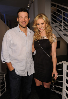 DALLAS, TX - FEBRUARY 05:  Dallas Cowboys Quarterback Tony Romo (L) and television personality Candice Crawford attend a private dinner hosted by Audi during Super Bowl XLV Weekend at the Audi Forum Dallas on February 5, 2011 in Dallas, Texas.  (Photo by
