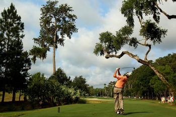 PONTE VEDRA BEACH, FL - MAY 12:  Matt Kuchar hits a tee shot on the sixth hole during the first round of THE PLAYERS Championship held at THE PLAYERS Stadium course at TPC Sawgrass on May 12, 2011 in Ponte Vedra Beach, Florida.  (Photo by Streeter Lecka/G