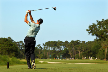 PONTE VEDRA BEACH, FL - MAY 12:  Jim Furyk hits his tee shot on the seventh hole during the first round of THE PLAYERS Championship held at THE PLAYERS Stadium course at TPC Sawgrass on May 12, 2011 in Ponte Vedra Beach, Florida.  (Photo by Mike Ehrmann/G