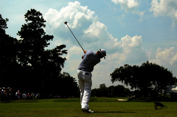 PONTE VEDRA BEACH, FL - MAY 13:  Davis Love III hits his tee shot on the ninth hole during the second round of THE PLAYERS Championship held at THE PLAYERS Stadium course at TPC Sawgrass on May 13, 2011 in Ponte Vedra Beach, Florida.  (Photo by Mike Ehrma